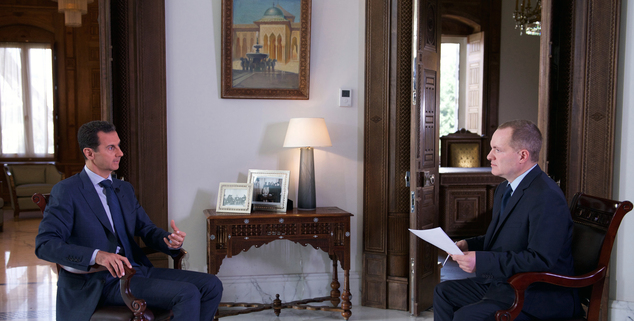 In this Wednesday, Sept. 21, 2016 photo released by the Syrian Presidency, Syrian President Bashar Assad, left, speaks to Ian Phillips, Vice President, Inter...