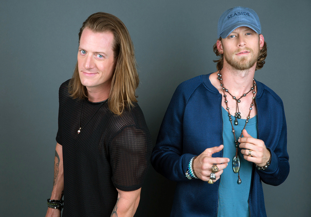 """In this Aug. 25, 2016 photo, Tyler Hubbard, left, and Brian Kelley of Florida Georgia Line pose for a portrait in New York to promote their latest album, """"Di..."""