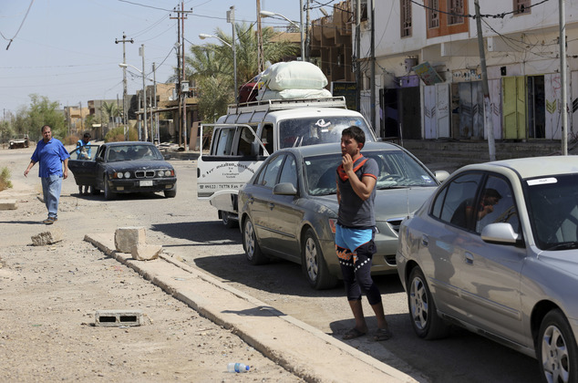 FILE -- In this Wednesday, Sept. 21, 2016 file photo, internally displaced Iraqis return to Fallujah, 40 miles (65 kilometers) west of Baghdad, Iraq. Three d...