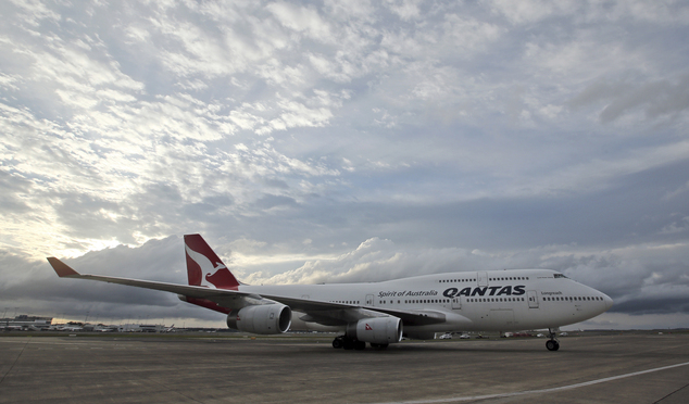 FILE - In this Tuesday, Sept. 13, 2016 file photo, a Qantas jet taxis on the runway at Sydney Airport in Sydney, Australia. Around 100 passengers on board a ...