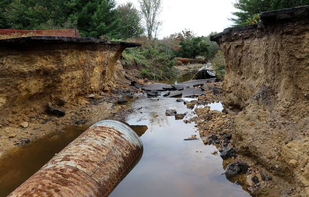 Heavy rains forced closure of many roads, including this washout just south of Cadott, Wis., in Chippewa County on Hwy MM, Thursday,  Sept.22, 2016. It's a s...