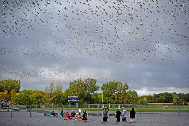Members of the football team  check out the flooding on the football field near the Waseca High School, Thursday, Sept.  22, 2016 in Waseca, Minn.  Thursday,...
