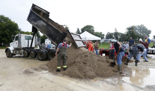 A truck brings another load of sand for sandbags as the Shell Rock River continues to rise in Greene, Iowa, Thursday, Sept. 22, 2016. Several Midwestern stat...