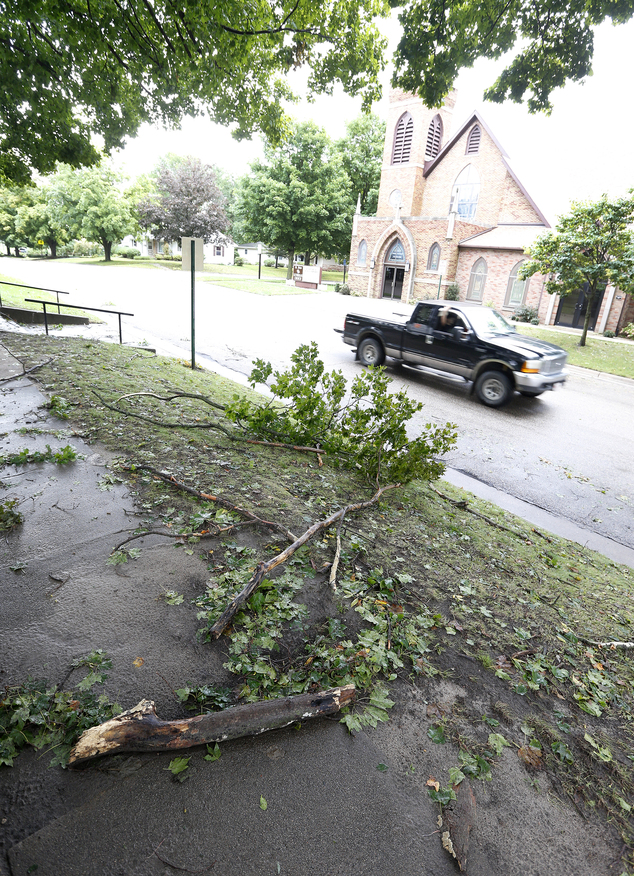 Fallen branches lay on the sidewalks and streets from overnight storms in Greene, Iowa, Thursday, Sept. 22, 2016. Several Midwestern states were a soggy mess...