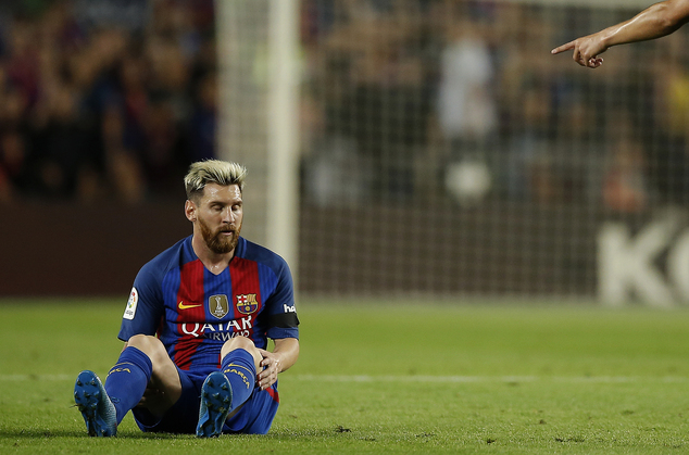 FC Barcelona's Lionel Messi pauses during the Spanish La Liga soccer match against Atletico Madrid at the Camp Nou in Barcelona, Spain, Wednesday, Sept. 21, ...