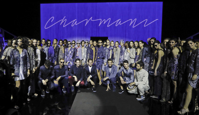 Models pose on the catwalk at the end of the Giorgio Armani women's Spring-Summer 2017 show, that was presented in Milan, Italy, Friday, Sept. 23, 2016. (AP ...