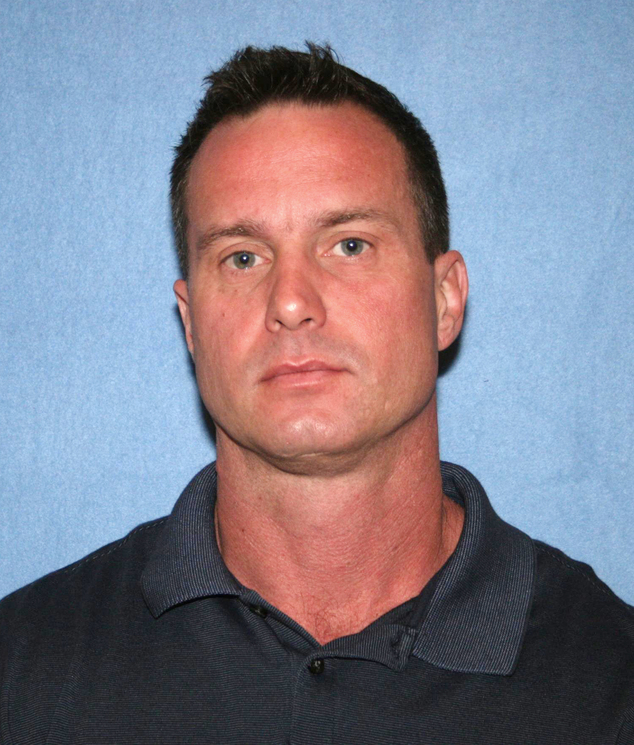 This undated photo provided by the Phoenix Police Department shows Officer Jason E. McFadden. McFadden is one of three Phoenix police officers who have resig...
