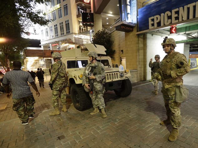 National Guardsman stand on the street in downtown Charlotte, N.C. on Thursday, Sept. 22, 2016. Charlotte police refused under mounting pressure Thursday to ...