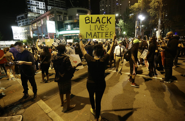 Protesters take to the streets of uptown during a peaceful march following Tuesday's police shooting of Keith Lamont Scott in Charlotte, N.C., Thursday, Sept...