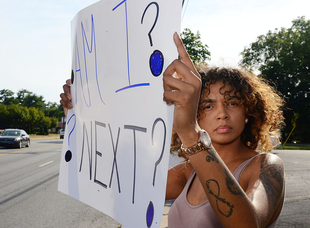 Jadah Blair holds a sign up during a demonstration on Wednesday. Her sign reads: 'Am I next?'