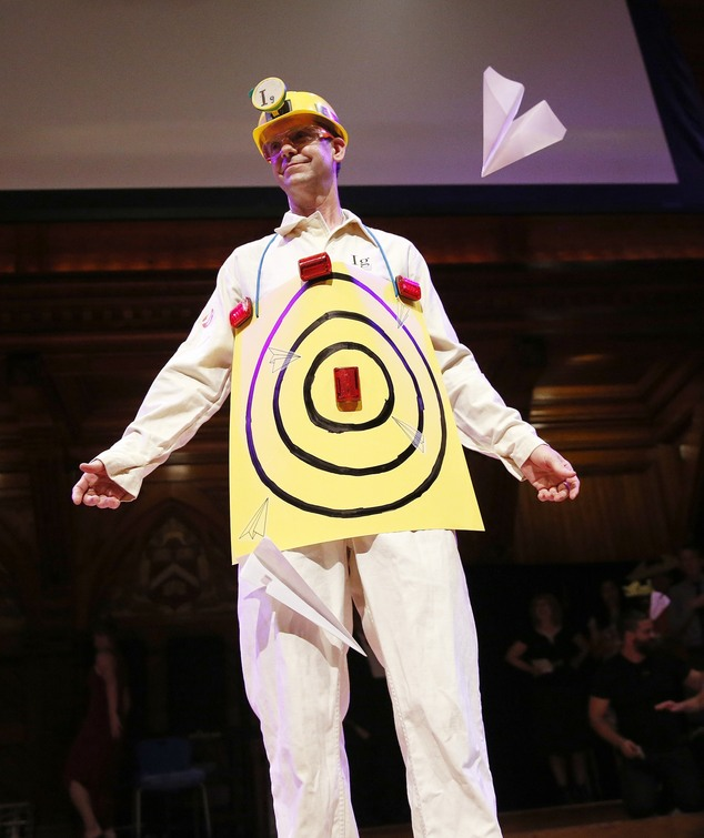 Human Aeorodrome Eric Workman acts as a target for paper airplanes during the Ig Nobel award ceremonies at Harvard University in Cambridge