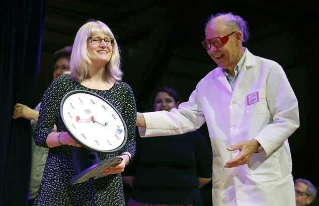 Susanne Akesson, left, accepts the Ig Nobel prize in physics. Akesson, from Lund University in Sweden, was part of a team that discovered why white-haired horses are the most horsefly-proof horses and for discovering why dragon flies are fatally attracted to black tombstones