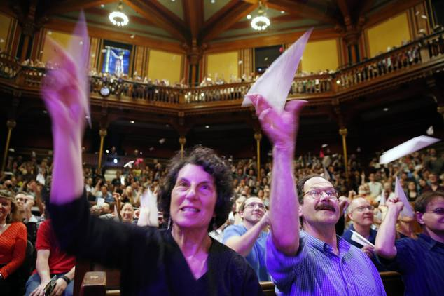 Audience members throw paper airplanes during the Ig Nobel award ceremonies at Harvard University in Cambridge, Mass