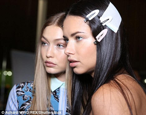 Model pals: Gigi and Adriana cuddled up to take snaps before storming the runway together