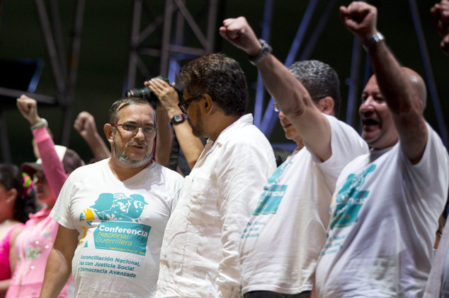 The top leader of the Revolutionary Armed Forces of Colombia, FARC, Rodrigo Londono, also known as Timochenko, far left, talks to the group's main negotiator...