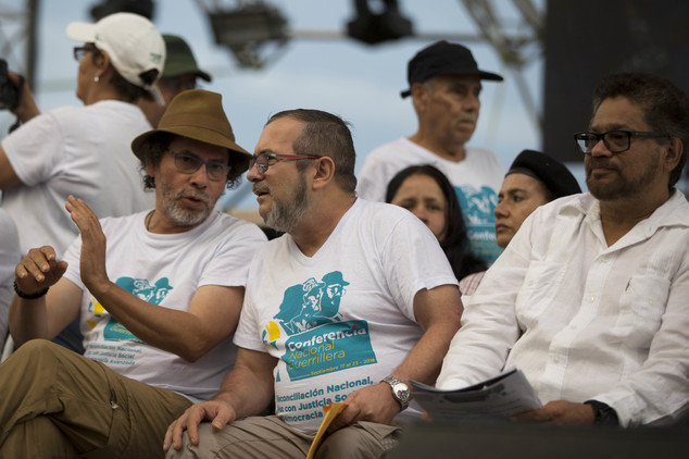Rebel leaders Rodrigo Londono, center, Ivan Marquez, right, and Pastor Alape, left, attend the closing event of the 10th conference of the Revolutionary Arme...