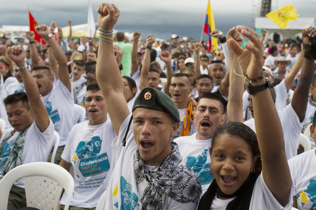 Rebels cheer during the closing event of the 10th conference of the Revolutionary Armed Forces of Colombia, FARC, in Yari Plains, Colombia, Friday, Sept. 23,...