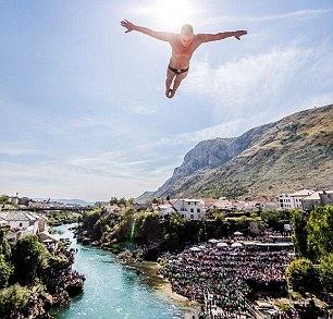 Daredevil divers from across the world plunge 92ft from a bridge as they competed to be crowned champion of the 2016 Red Bull Cliff World Series