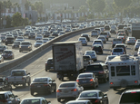 This Sept. 9, 2016 photo shows rush hour traffic moving along the Hollywood Freeway in Los Angeles. California's traffic-locked roads are being considered for their potential to serve a new purpose as clear power producers. After several years studying the technology, the California Energy Commission is soliciting companies and universities to create small-scale field tests to investigate whether the waste energy created by vehicles, and passed onto roads when driving, could be captured and turned into electricity. (AP Photo/Richard Vogel)
