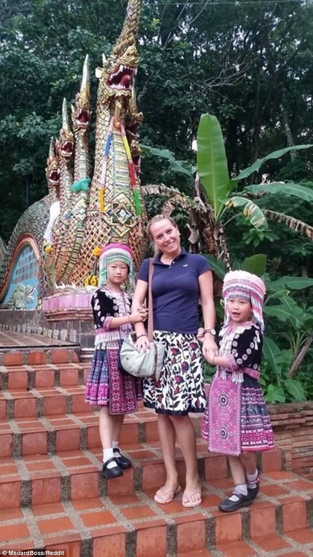 A man has captured the moment two young pickpockets slipped his girlfriend's watch from her wrist as she posed for a photograph with them at a Thai temple