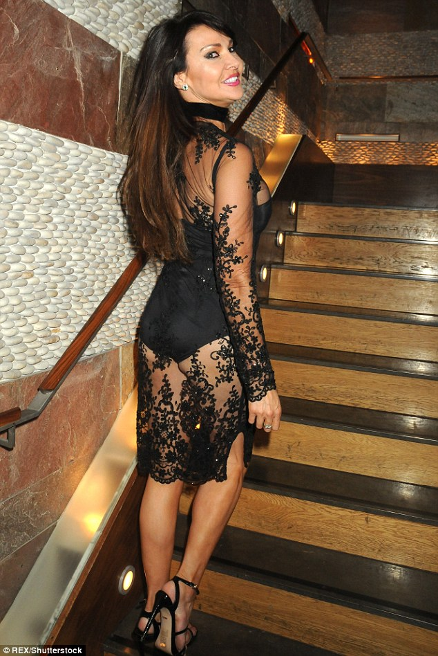 Perky: TV personality Lizzie Cundy wore a very sexy leotard under a lace dress as she  launched her own lingerie collection on Sunday at London's Mint Leaf Restaurant