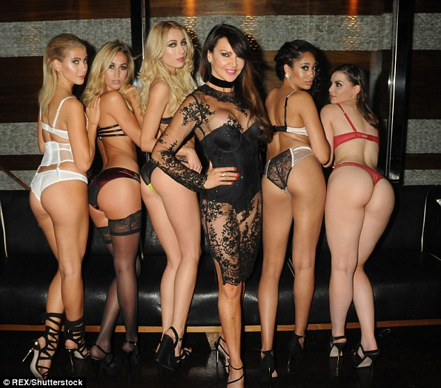 Bottoms up! The 48-year-old continued to ramp up the sex factor alongside her bevy of underwear clad models as she teetered into her event in a stiletto sandal