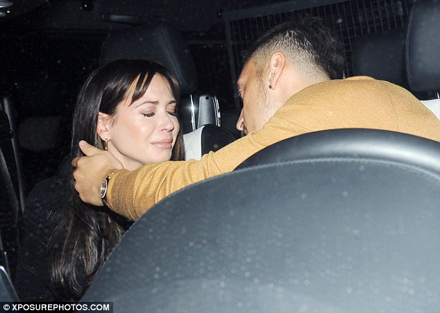 Tears: Mesut Ozil was seen with his teary-eyed girlfriend Mandy Capristo as they sat in a car outside London hotspot Libertine on Saturday night
