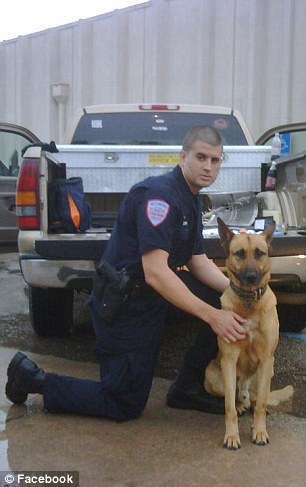 Barrett, pictured with a K-9 dog, continued to bang his baton on the car to keep the dogs' attention until animal control arrived at the scene