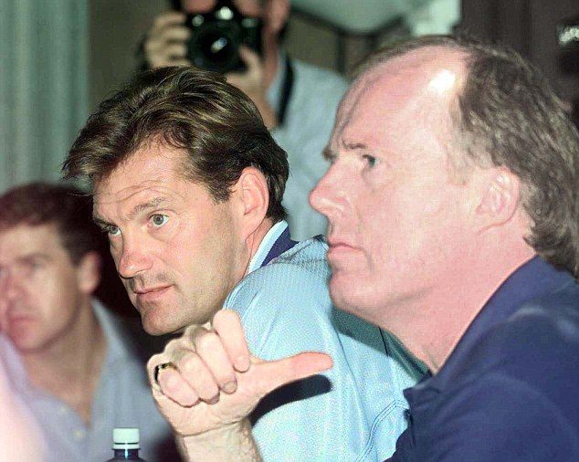 Hoddle at a 1998 press conference alongside then FA head of communications David Davies