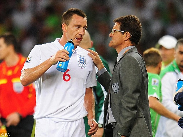 Fabio Capello, right, spoke out against the FA for stripping John Terry of the England armband