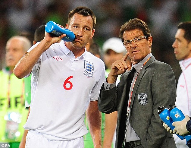 Capello is pictured with Terry during the miserable World Cup campaign of 2010