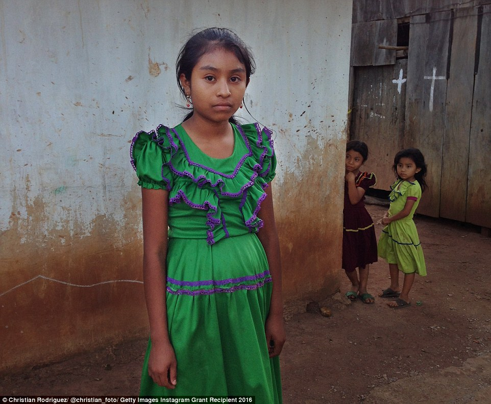 Christian Rodriguez took this portrait of (left to right) Graciela, 13, Norma, eight, and Lupita, seven, behind their house in the impoverished village of Ocotal Grande in Veracruz, Mexico