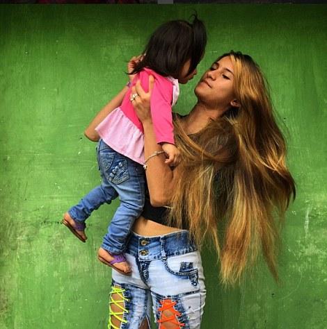 Yerli holds her daughter