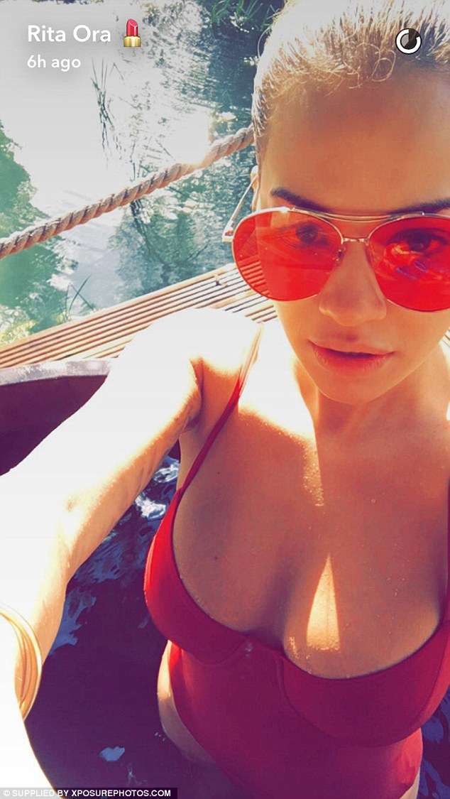 Red hot: Rita Ora, 25, certainly set pulses racing in a busty close-up selfie of herself in a sexy red swimsuit