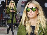Nicky Hilton swamps her post-pregnancy figure in furry green jacket in NYC