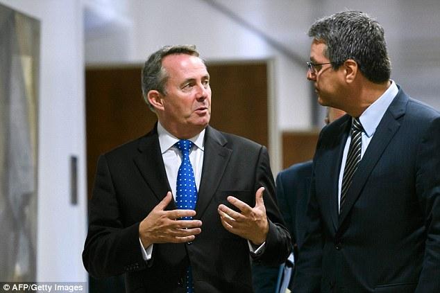 International Trade Secretary Liam Fox, pictured left with WTO director general Roberto Azevedo in Geneva today