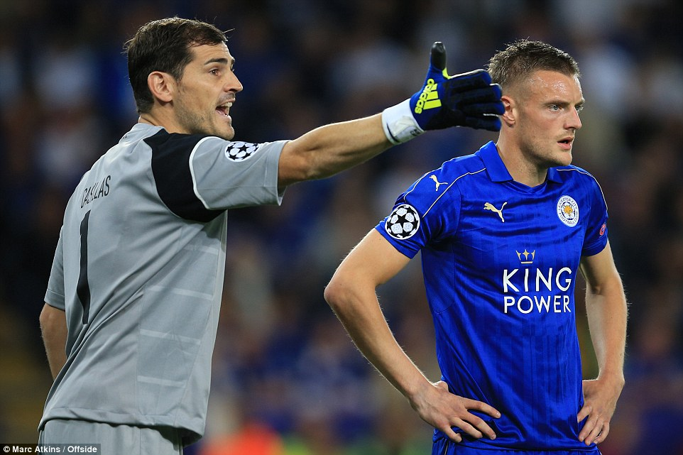 Former Real keeper Iker Casillas (left) instructs his defence as Jamie Vardy loiters close to goal