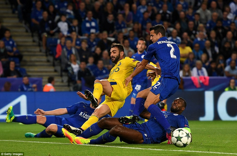 Porto forward Adrian Lopez (centre) is overwhelmed by Leicester players as he tries to get a shot away