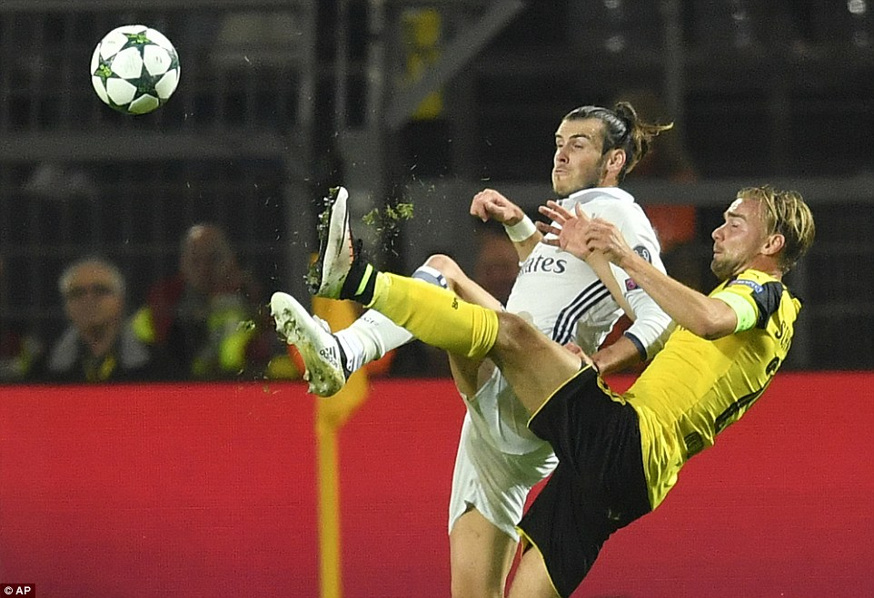 Wales star Gareth Bale gets physical with Dortmund defender Marcel Schmelzer  as the visitors take an early lead