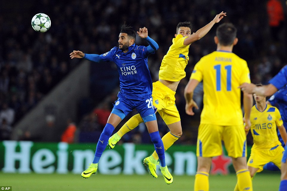 Last season's Premier League player of the Year Riyad Mahrez takes part in an aerial battle