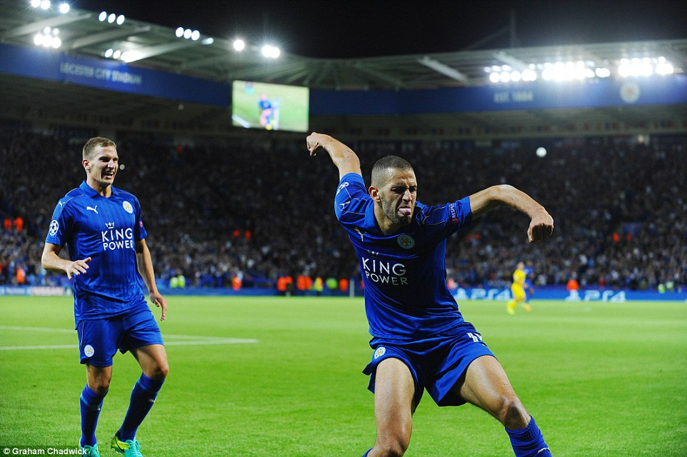 The so-called 'King of Headers' races to the corner flag to celebrate Leicester's opening goal on 25 minutes