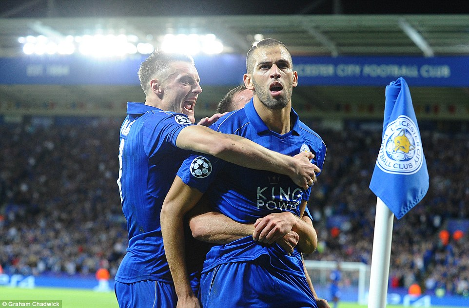 Jamie Vardy (left) races to celebrate Leicester's first ever Champions League home goal with scorer Slimani