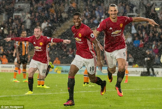 Rooney (left) set up Marcus Rashford's (centre) dramatic late winner at Hull