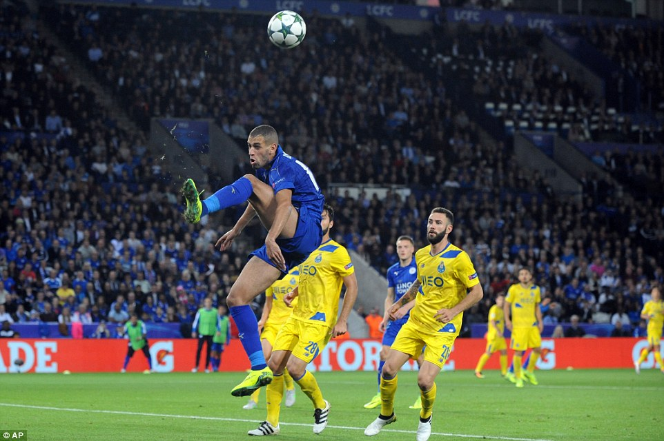 Slimani tries to control a high cross as Leicester strive to hold out in the closing stages of the match