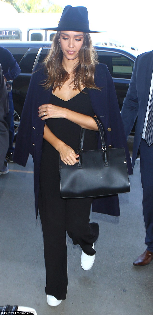On the move again: Jessica Alba looked stylish as always as she arrived at LAX on Tuesday to catch a flight out of Los Angeles
