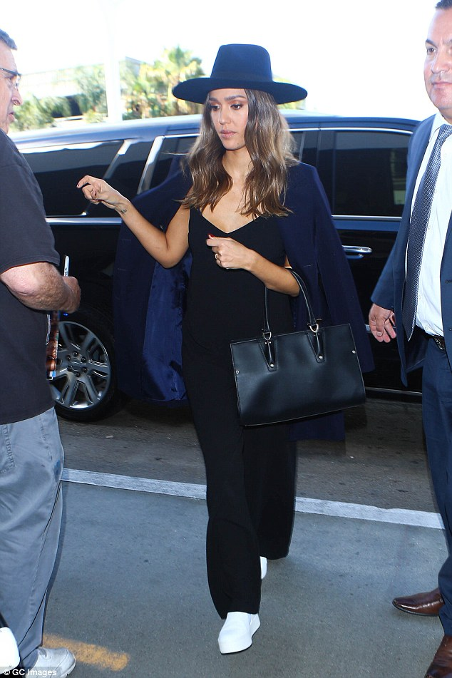 Dressed for travel: The actress turned entrepreneur donned a wide-brimmed fedora and a v-neck sleeveless black jumpsuit and carried a large black purse