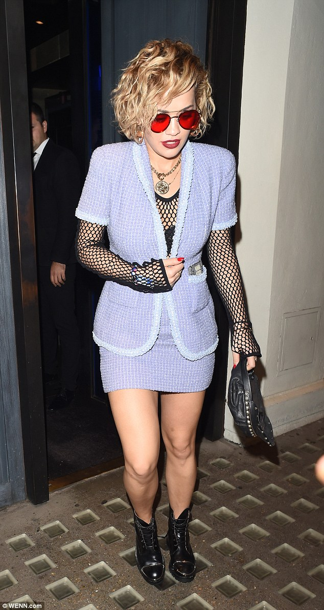 Chic and cheerful:Rita Ora didn't disappoint as she donned a classic ensemble with a twist for Britney Spears' concert in London on Tuesday night