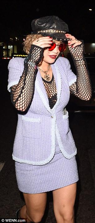 Rita Ora Shows Off Shorter Locks As She Puts A Saucy Spin