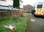 Tribute: Flowers have been left close to the home where a toddler's body was discovered this morning