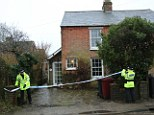 Crime scene: Police officers seal off Cherry Tree Cottage in Ashling, West Sussex, after the body of a woman named as Debbie Levey was found yesterday